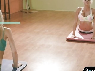 Two babes learned new yoga techniques by busty trainer