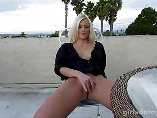 Sexy blonde lady flashes in public and toys her pussy