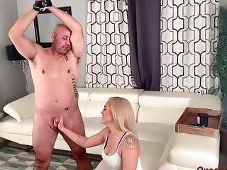 Blonde slut with nice tits strokes cock after foot worship